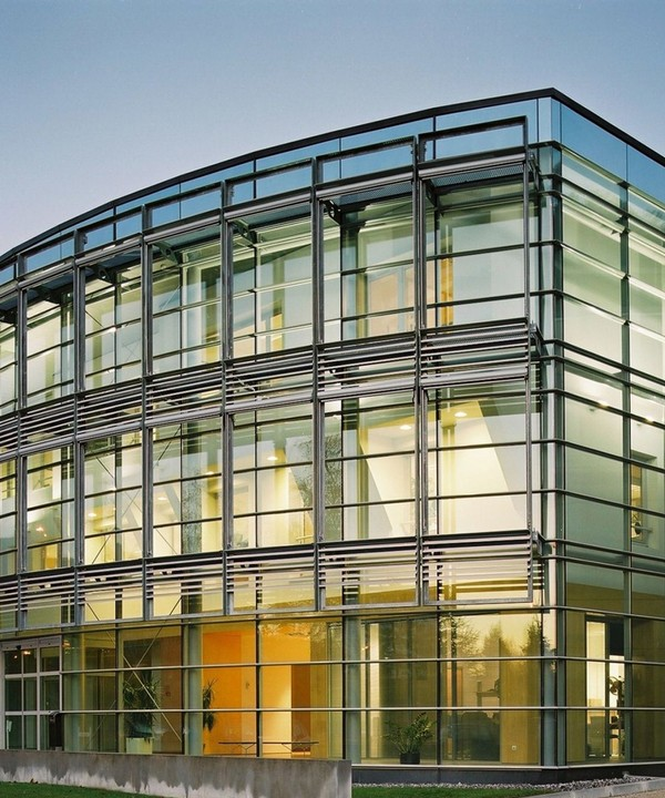 commercial building with glass facade & window shades